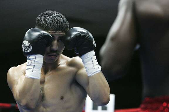 San Antonio boxer James Cantu prepares to knock out Forrest Curry of Ft Worth 38 seconds into the first round during the1st Annual Oscar Diaz Fight Night at Randy's Ballroom on the west side, Saturday, September 26, 2009. JENNIFER WHITNEY/ jwhitney@express-news.net