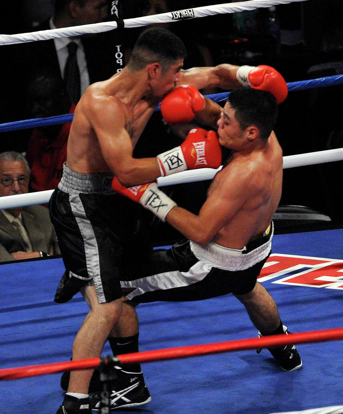 James Cantu of San Antonio knocks down Antonio Games of Laredo in the third round of their super-lightweight division bout during the Latin Fury boxing event at the Alamodome on Saturday, June 26, 2010. Cantu won by unanimous decision. BILLY CALZADA / gcalzada@express-news.net