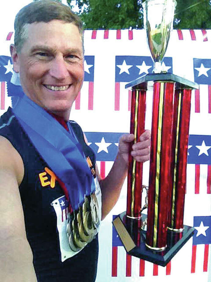 Mike Young of Wood River displays the Outstanding Male Athlete trophy he was awarded at the recent American Masters Track and Field Championships held in Durham, N.C. Photo:       Submitted Photo