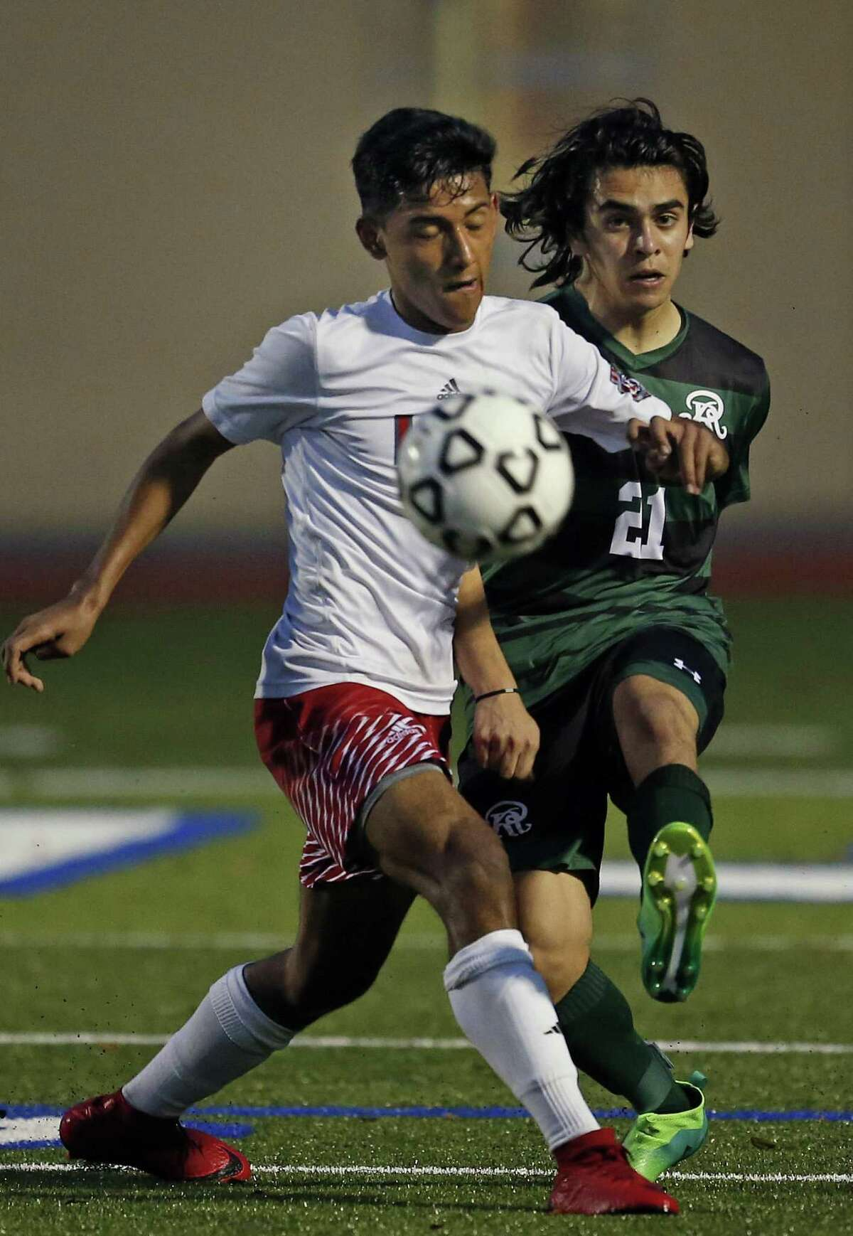 Lees?' Antonio Loyola watches as Reagans?' Andreas Christodoulou kicks the ball past him from District 26-6A high school boys soccer showdown between No. 1 Reagan and No. 2 Lee on Tuesday, February 6, 2018 at Comalander Stadium