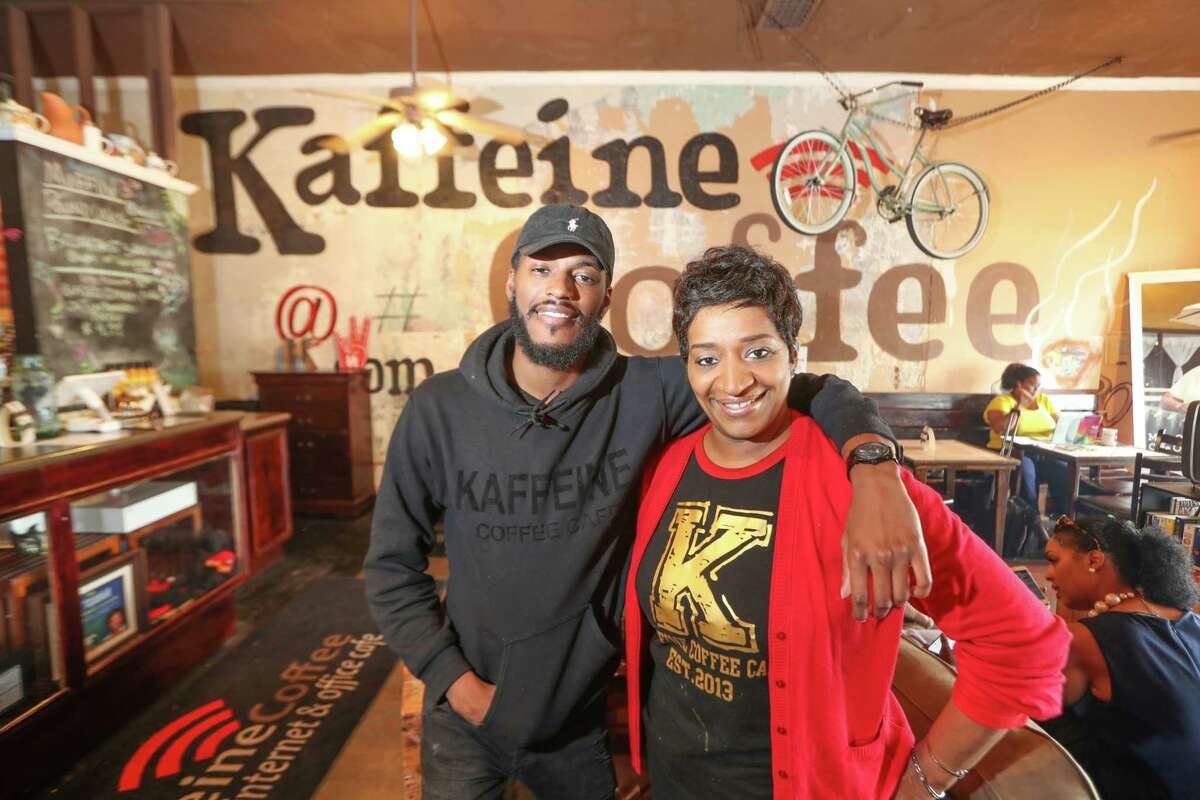Christopher Rashard and his mother, Orgena Keener, co-owners of Kaffeine Coffee, pose for a photo Wednesday, April 18, 2018, in Houston.