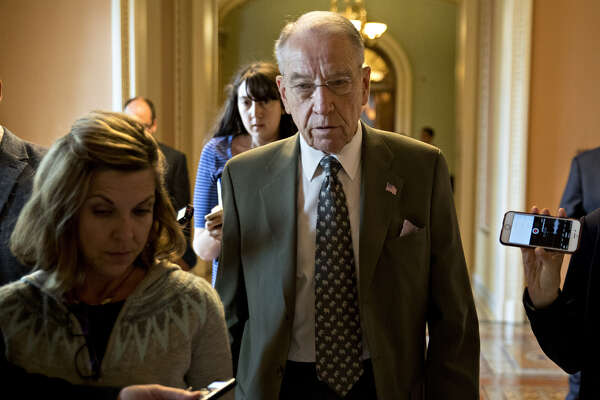 Sen. Chuck Grassley, R-Iowa, speaks to members of the media while walking to a closed-door GOP conference meeting to discus tax reform at the U.S. Capitol in Washington on Nov. 9, 2017.