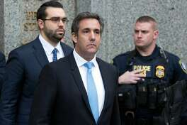 FILE - In a Monday, April 16, 2018 file photo, Michael Cohen, President Donald Trump's personal attorney, center, leaves federal court, in New York. FBI raids on the office and residence of Cohen have raised thorny questions about attorney-client privilege, and the ability of the attorney, Michael Cohen, to keep communications with his high-powered clients private. Fox News host Sean Hannity said he was wrongly dragged into the case when a judge forced Cohen's lawyers to reveal the names of his recent clients on Monday. (AP Photo/Mary Altaffer, File)