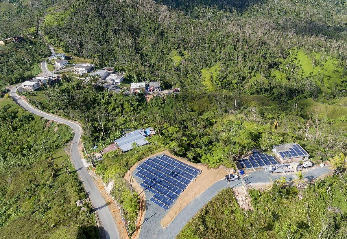 """FILE-- Tesla said over 1,000 Tesla batteries were on the ground in Puerto Rico delivering power at 662 locations.In the hours after Puerto Rico went dark, Elon Musk, co-founder and CEO of Tesla, tweeted Wednesday, """"Tesla batteries are currently live & delivering power at 662 locations in Puerto Rico. Team is working 24/7 to activate several hundred more."""""""