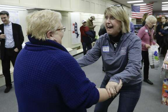 Wisconsin Democratic party chair Martha Laning meets Wisconsin assembly candidate Ann Groves Lloyd at an event at the offices of Columbus County Democratic Party Saturday, April 14, 2018, in Portage, Wis. (AP Photo/Morry Gash)