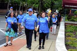 FILE PHOTO: Shirley Brazel Sklar, right, and husband Bill Sklar carry the torch through the first leg of the JCC Maccabi Torch Relay on Sunday, May 22, 2016. The Jewish Community Center of Stamford held the JCC Maccabi Torch Relay to commemorate the JCC's 100th year.