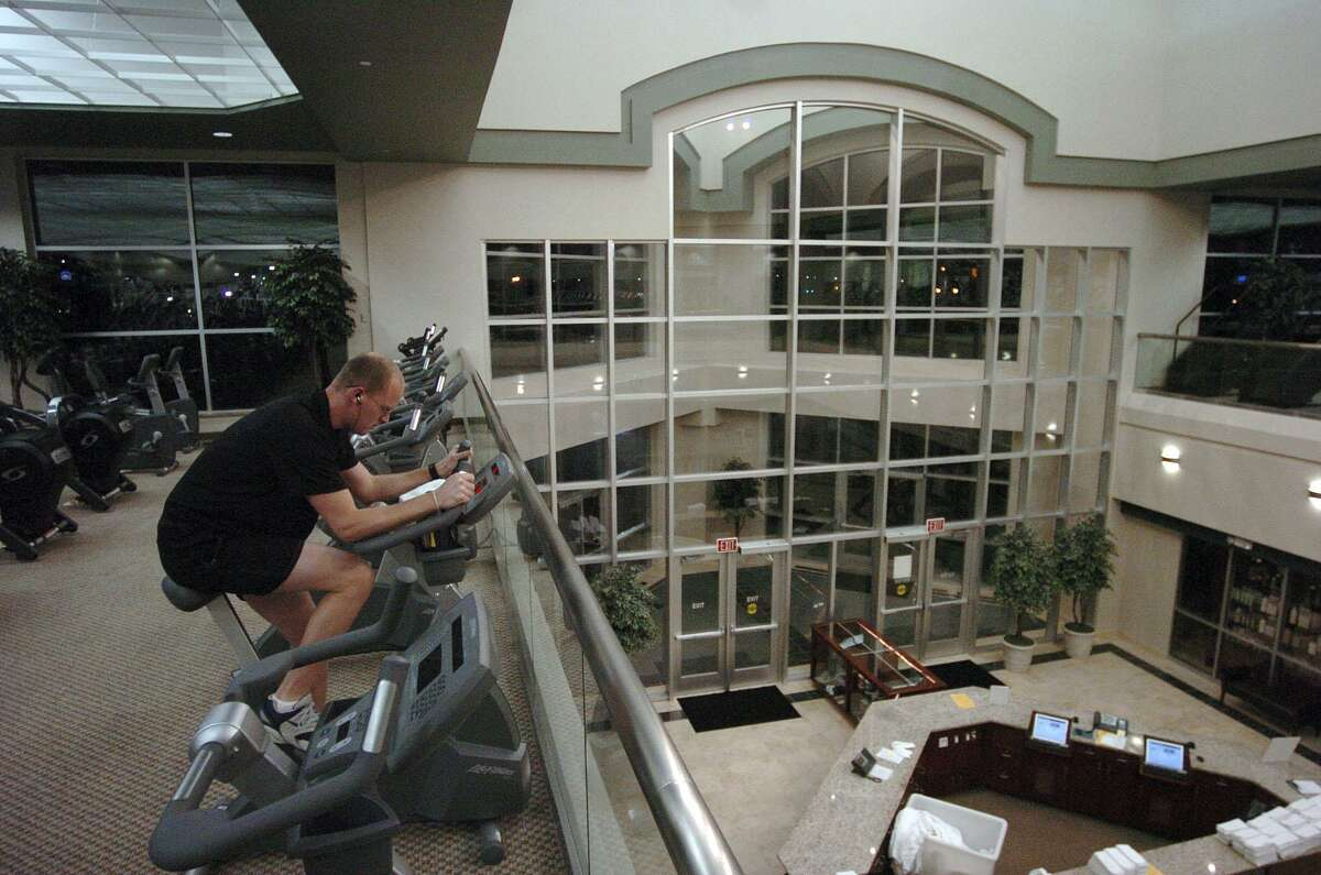 A man works out at 2 a.m. at a Life Time Fitness in San Antonio, Texas, in this file photo.