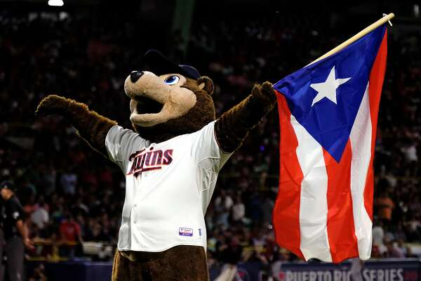 SAN JUAN, PUERTO RICO - APRIL 18:  Minnesota Twins mascot TC Bear carries the Puerto Rican flag before the start of a game against the Cleveland Indians at Hiram Bithorn Stadium on April 18, 2018 in San Juan, Puerto Rico. (Photo by Ricardo Arduengo/Getty Images)
