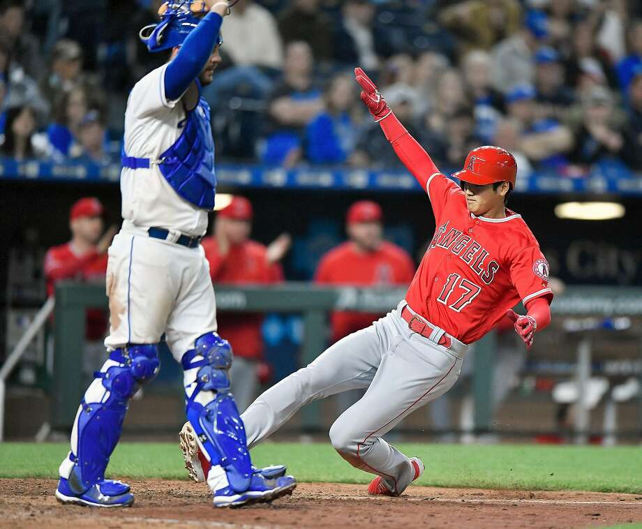 The Los Angeles Angels' Shohei Ohtani scores in front of Kansas City Royals catcher Drew Butera on a sacrifice fly by Ian Kinsler in the eighth inning on Friday, April 13, 2018, at Kauffman Stadium in Kansas City, Mo. The Angels won, 5-4. (John Sleezer/Kansas City Star/TNS) Photo: John Sleezer / TNS