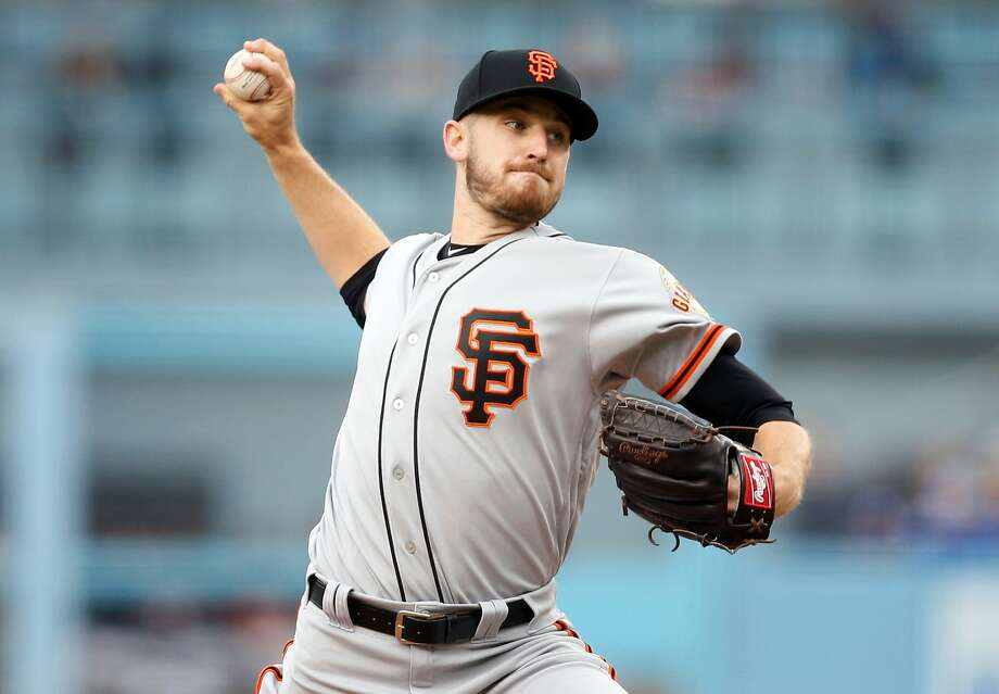 San Francisco Giants starting pitcher Chris Stratton delivers against the Los Angeles Dodgers during the first inning of a baseball game Sunday, April 1, 2018, in Los Angeles. (AP Photo/Danny Moloshok) Photo: Danny Moloshok / Associated Press