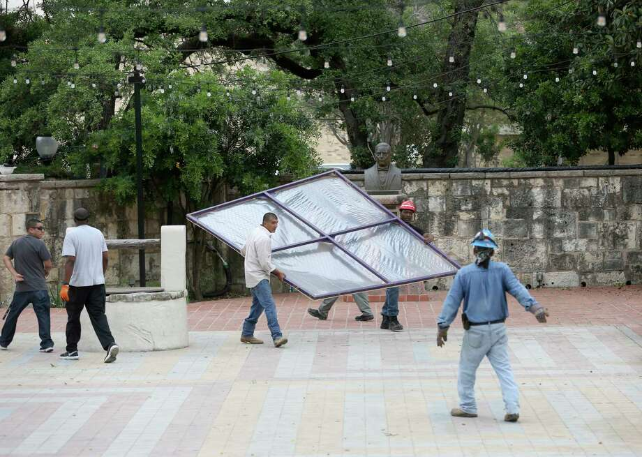 Workers begin Wednesday, April 18, 2018 to place parts in La Villita's Juarez Plaza of what will eventually become A night in Old San Antonio booths. NIOSA runs April 24-25. Photo: William Luther, San Antonio Express-News / © 2018 San Antonio Express-News