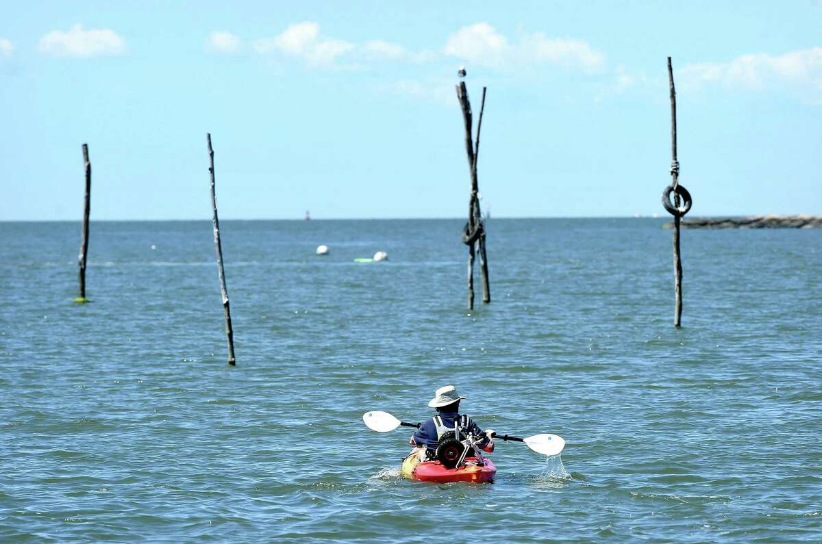 A man kayaks away from shore in the Stony Creek section of Branford on 6/26/2017. Arnold Gold / Hearst Connecticut Media