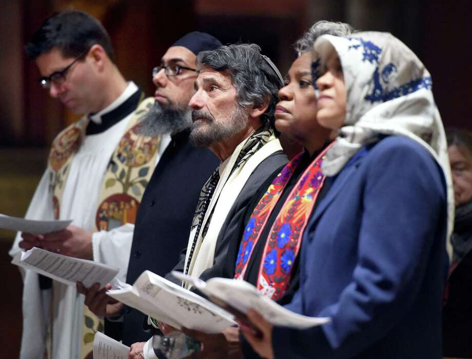 (Arnold Gold-New Haven Register)  Rabbi Herbert Brockman (center) of Congregation Mishkan Israel in Hamden and area clergy participate in the Interfaith Prayer Service opening the 200th Anniversary Celebration of Trinity Episcopal Church on the New Haven Green on 1/17/2016.