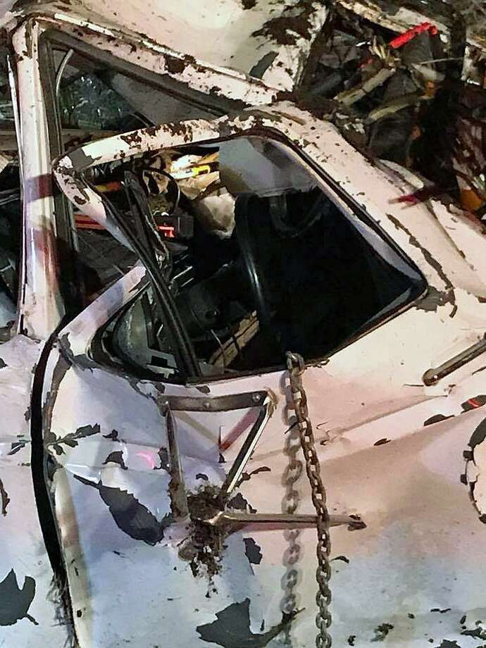 A 46-year-old East Haven, Conn., man did not suffer any injuries in a rollover crash on Route 8 on April 18, 2018. Photo: Contributed Photo / Derby Fire Department / Contributed Photo / Connecticut Post Contributed