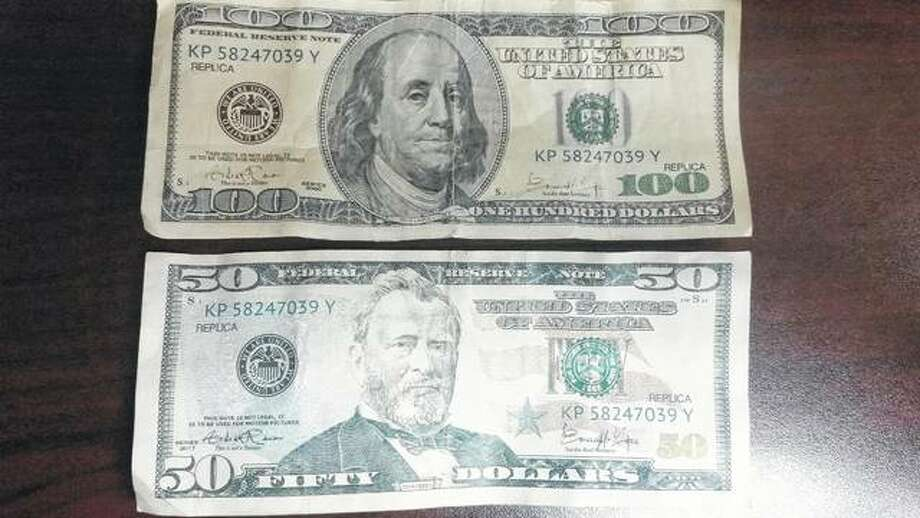Two of the counterfeit bills collected by the White Hall Police Department. Photo:       For The Telegraph