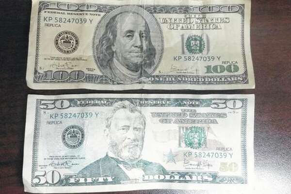 Two of the counterfeit bills collected by the White Hall Police Department.