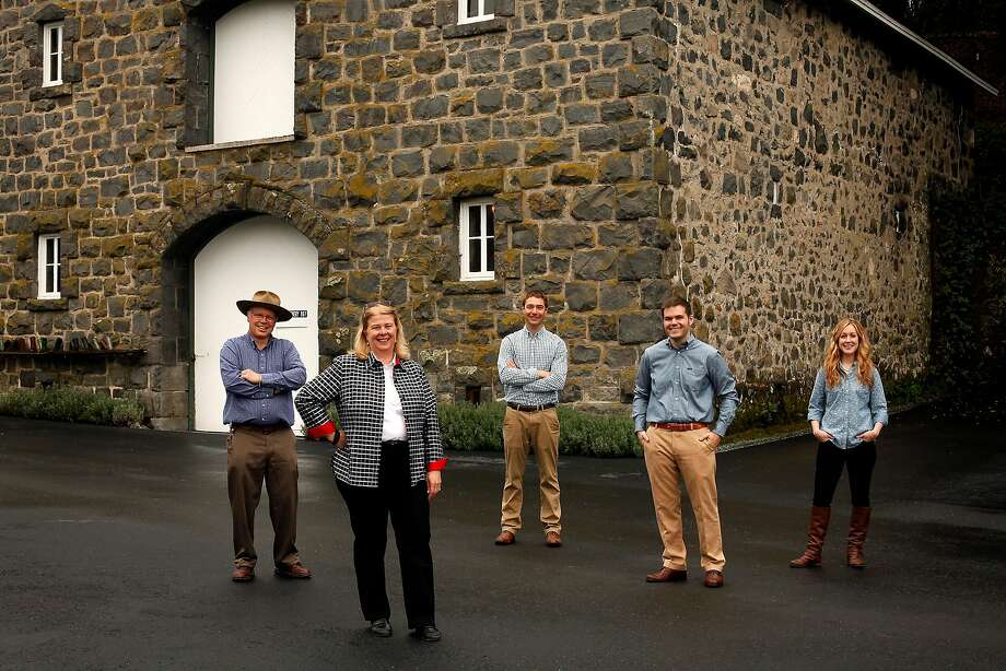 David Heitz (left), his sister Kathleen Heitz Myers, Eric White, Harrison Heitz and Brittany Sherwood are seen at Heitz Wine Cellars in St. Helena in 2014. The Heitz family has sold the winery to Gaylon Lawrence Jr. for an undisclosed price. Photo: Sarah Rice / Special To The Chronicle 2014