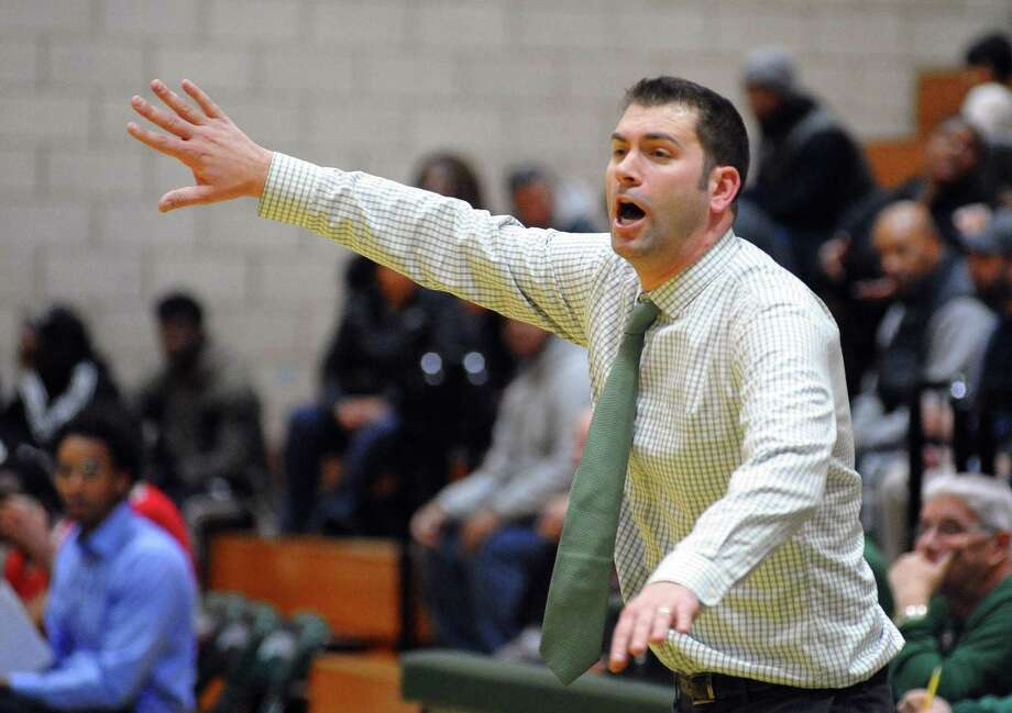 Norwalk boys basketball coach Tom Keyes directs his team this past season. He resigned on Thursday. Photo: Christian Abraham / Hearst Connecticut Media / Connecticut Post