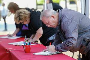 Bob Jensen (right) and Rhonda Watts, both from Idaho, signed memory books for the Bush Family Thursday, April 19, 2018, in Houston. The Houston community was invited to the Barbara Bush Literacy Plaza to pay tribute and share their memories of the First Lady.
