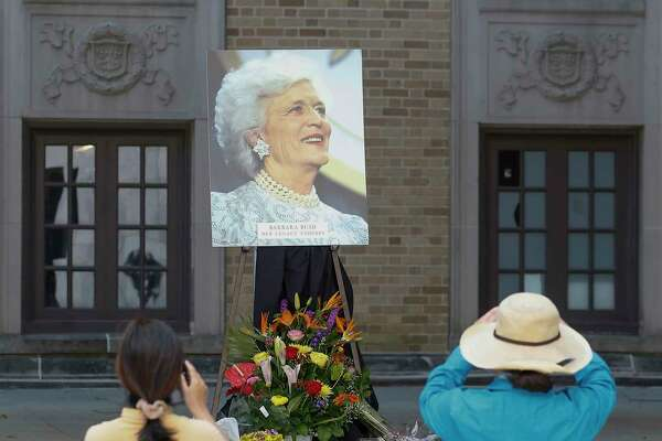 memory book for the Bush Family People shot photos of Barbara Bush's portrait Thursday, April 19, 2018, in Houston. The Houston community was invited to the Barbara Bush Literacy Plaza to pay tribute and share their memories of the First Lady.