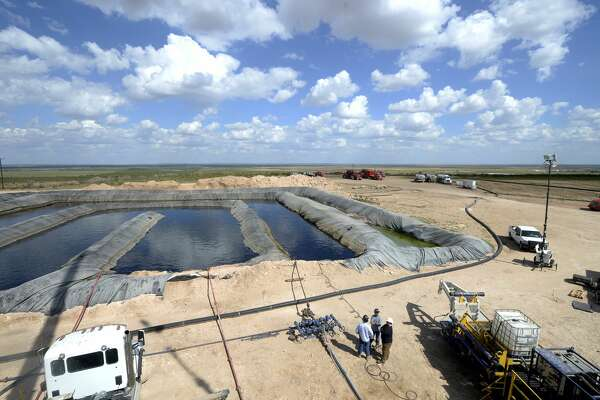 Water pools attaching to a fracking site managed by Octane Energy on Friday, Sept. 23, 2016 near Stanton. James Durbin/Reporter-Telegram