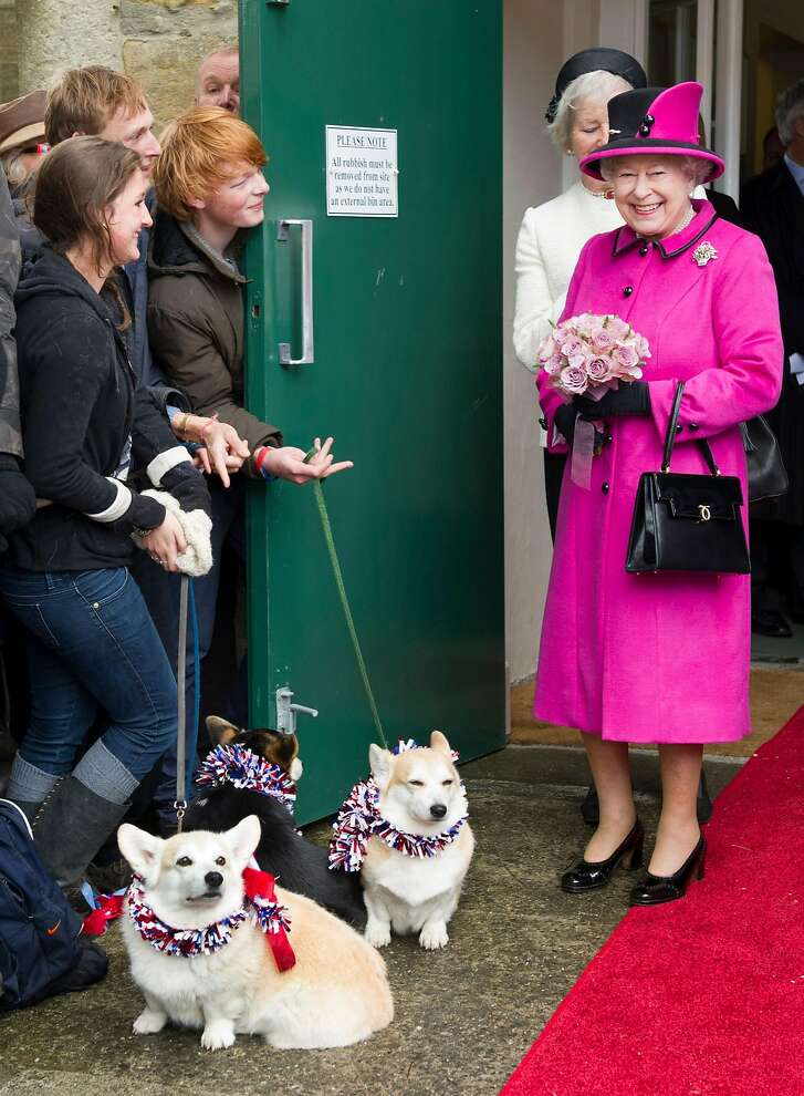 Britain's Queen Elizabeth II (R) meets members of the public with two corgi dogs during a visit at Sherborne in Dorest, southwest England, on May 1, 2012 during her Diamond Jubilee progress. AFP PHOTO / POOL / ARTHUR EDWARDSARTHUR EDWARDS/AFP/GettyImages
