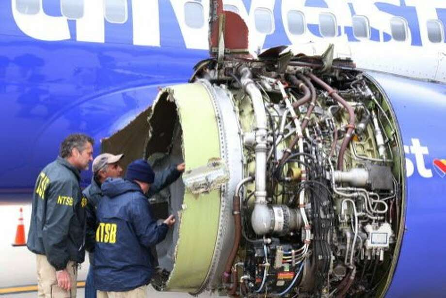 Investigators examine engine of the Southwest Airlines plane that made an emergency landing in Philadelphia. Photo: / Associated Press