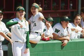 The Woodlands players chant to music during the sixth inning of a non-district high school softball game at The Woodlands High School, Wednesday, March 14, 2018, in The Woodlands.