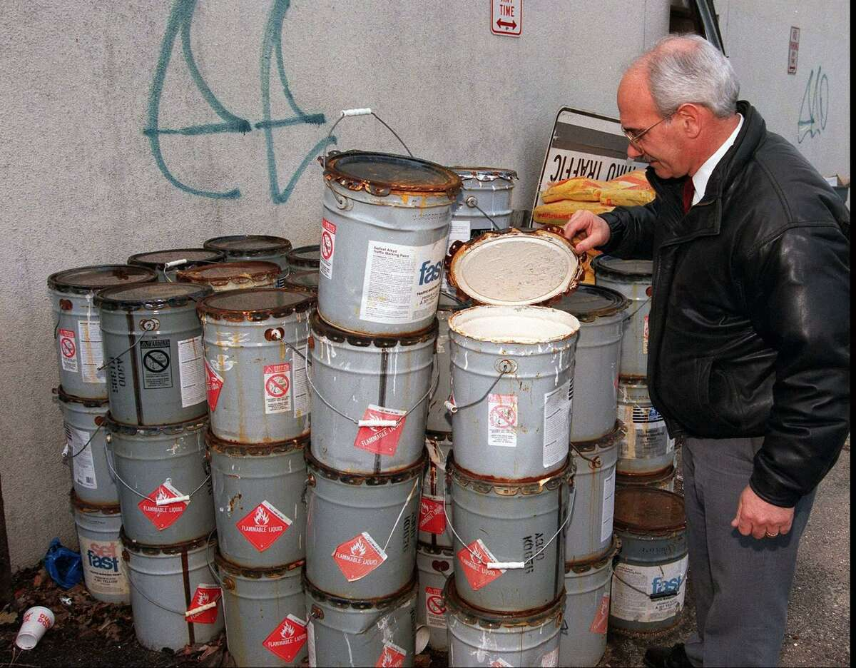 FILE PHOTO: Ernie Orgera looks over the spilled Thermoplastic at the Crescent St. facility of the Highways, Signs and Lines department