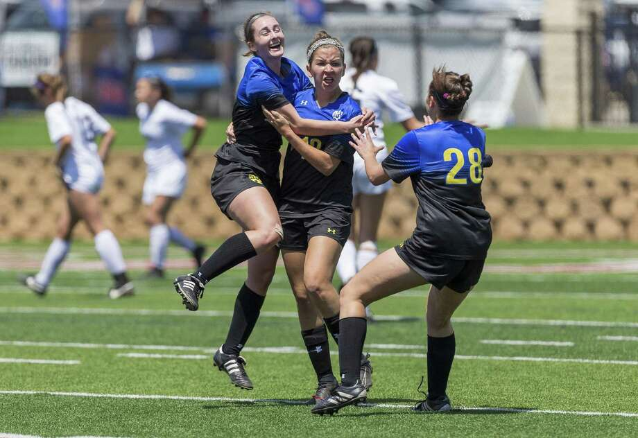 San Antonio Alamo Heights' Sophia Connelly (5) and Brenna Marshall (28) celebrate a goal by Dawson Brinkley, center, during the Class 5A girls soccer state semifinal in Georgetown, Thursday, April 19, 2018.  (Stephen Spillman) Photo: Stephen Spillman / Stephen Spillman / stephenspillman@me.com Stephen Spillman