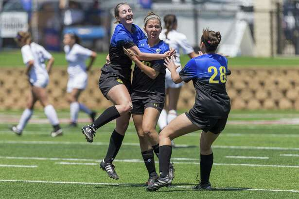 San Antonio Alamo Heights' Sophia Connelly (5) and Brenna Marshall (28) celebrate a goal by Dawson Brinkley, center, during the Class 5A girls soccer state semifinal in Georgetown, Thursday, April 19, 2018.  (Stephen Spillman)