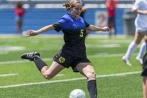 San Antonio Alamo Heights' Sophia Connelly kicks down field against Grapevine during the Class 5A girls soccer state semifinal in Georgetown, Thursday, April 19, 2018. (Stephen Spillman)