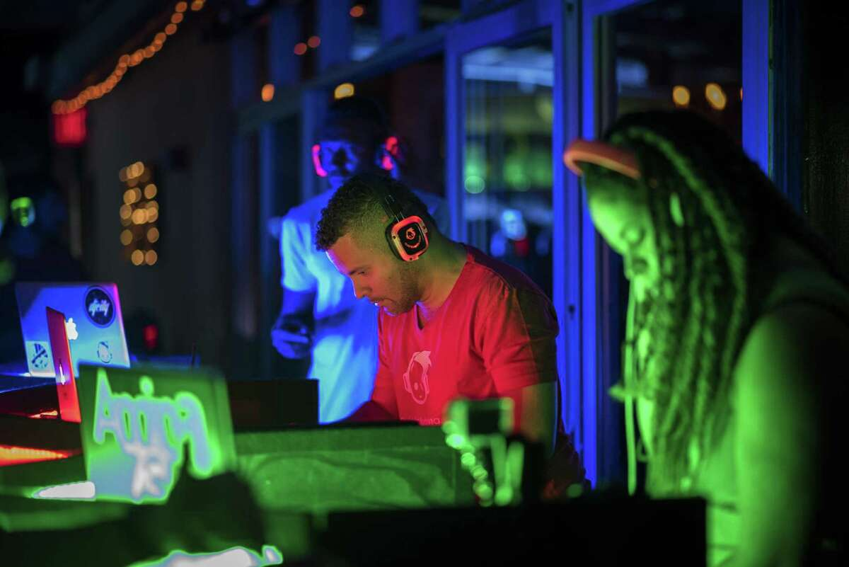 DJs play their favorite tunes on three different channels at a recent silent disco party. The Palace Theatre in Stamford will host one on April 26 to benefit its arts education programs.