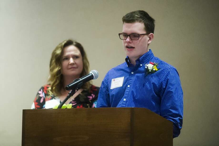 Bennett Veith speaks about coping with the death of his father, Andrew Veith, while his mother, Pattie Veith-Powers, stands next to him during the Children's Grief Center of the Great Lakes Bay Region's 4th annual Hearts of Hope Luncheon on Wednesday, April 18, 2018 at the Great Hall Banquet & Convention Center. (Katy Kildee/kkildee@mdn.net) Photo: (Katy Kildee/kkildee@mdn.net)
