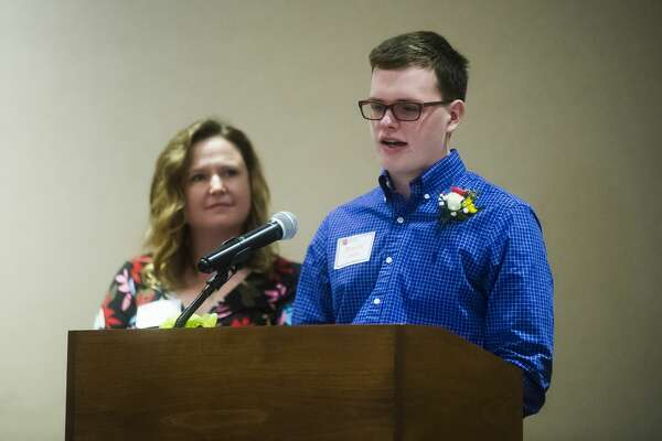 Bennett Veith speaks about coping with the death of his father, Andrew Veith, while his mother, Pattie Veith-Powers, stands next to him during the Children's Grief Center of the Great Lakes Bay Region's 4th annual Hearts of Hope Luncheon on Wednesday, April 18, 2018 at the Great Hall Banquet & Convention Center. (Katy Kildee/kkildee@mdn.net)
