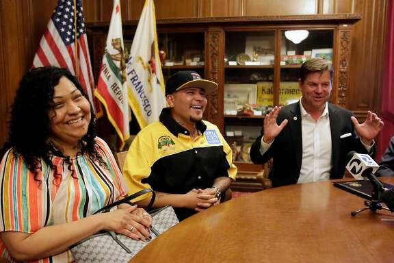 Sharing a lighter moment, Alberto Carrillo, with public works, with his wife Francisca Carrillo, is honored by the Mayor of San Francisco Mark Farrell, (right) at City Hall in San Francisco, Calif., on Thurs. April 19, 2018, for saving the lives of two people last month, at   Carrillo who works as Pitstop monitor, a bathroom area provided by public works, where he rescued one man from a drug overdose and another who was suffering from heart attack in the Tenderloin.