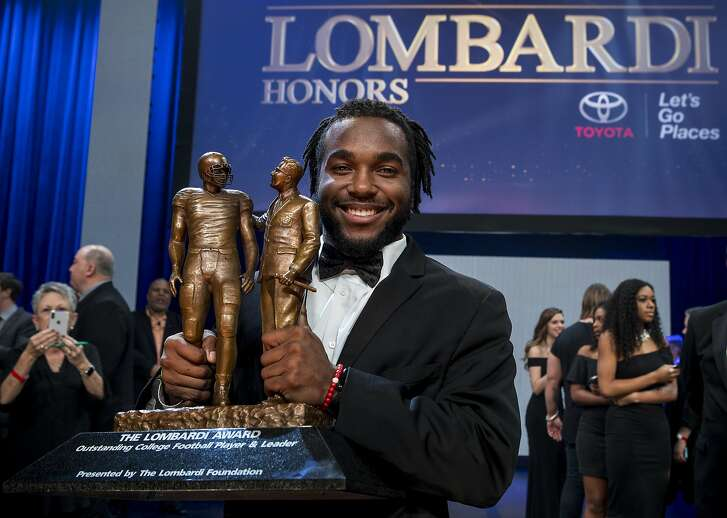 Stanford University junior running back Bryce Love poses for photos with the Lombardi Award trophy at Lone Star College Cy Fair on Saturday, Jan. 27, 2018, in Cypress, Texas. The annual award recognizes an NCAA Division I player, regardless of position, based on performance, leadership, character, and resiliency. ( Brett Coomer / Houston Chronicle )