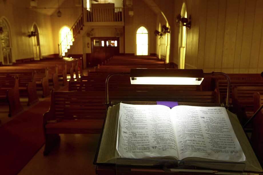 Evening light filters through colored windows at United Evangelical Lutheran Church on Sunday, March 25, 2012, in Swiss Alp , Texas. Photo: Smiley N. Pool, Staff / Houston Chronicle / © 2012  Houston Chronicle