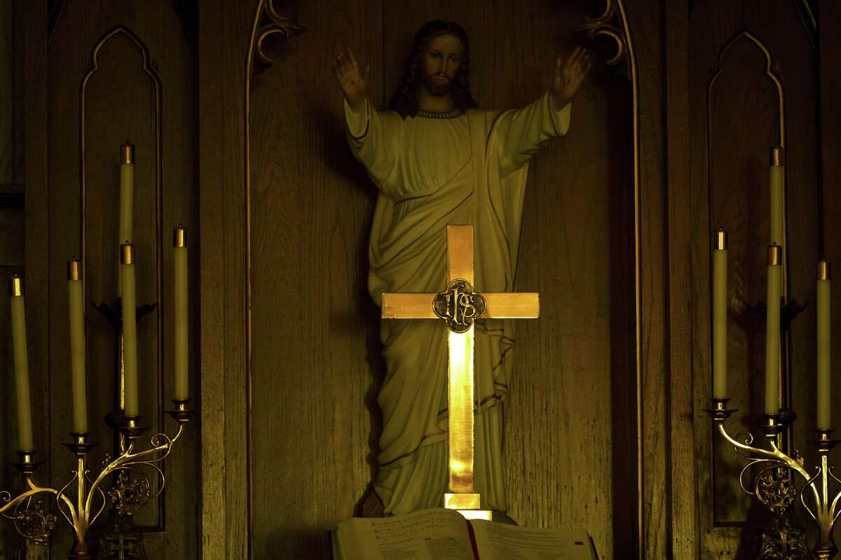 Light reflects on the altar at United Evangelical Lutheran Church on Sunday, March 25, 2012, in Swiss Alp , Texas.