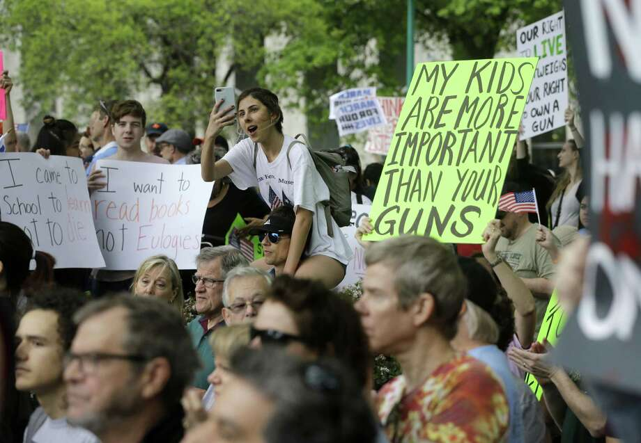 In this March file photo, people listen to speeches during a rally at Tranquility Park as they participate in the March For Our Lives in downtown Houston. ( Melissa Phillip / Houston Chronicle) Photo: Melissa Phillip, Staff / Houston Chronicle / © 2018 Houston Chronicle