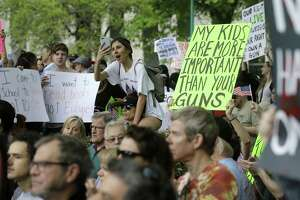 In this March file photo, people listen to speeches during a rally at Tranquility Park as they participate in the March For Our Lives in downtown Houston. ( Melissa Phillip / Houston Chronicle)