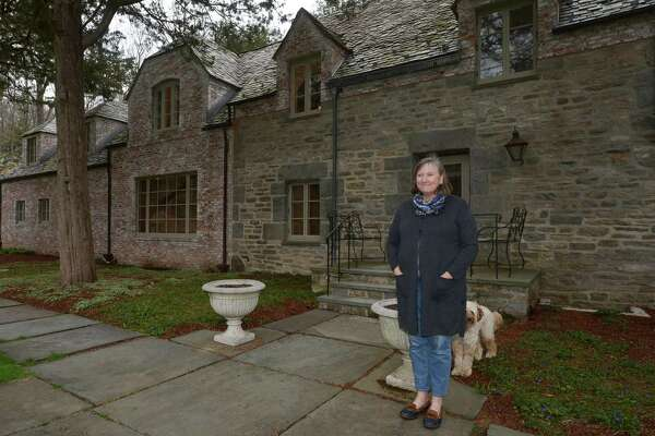 Barbara Rosiello and her dog, Fritzy, at her home at 55 Davis Hill Road Tuesday, April 17, 2018, in Weston, Conn. Many Metropolitan Opera singers and composers passed through the home at 55 Davis Hill Road in Weston, where famed conductor Fritz Reiner and his wife made their main residence in the 1930s.