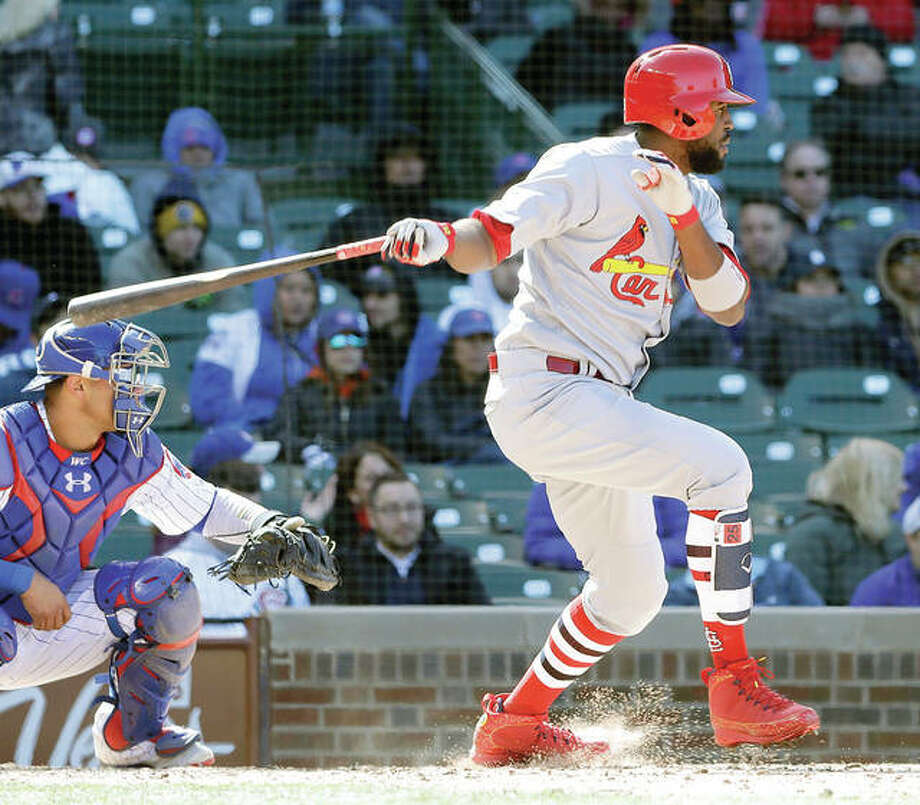 The Cardinals' Dexter Fowler hits into a fielder's choice in the seventh inning Thursday in Chicago. Fowler was safe at first on a throwing error by Cubs second baseman Javier Baez, as Jedd Gyorko, and Paul DeJong scored on the play. Photo:       AP