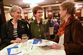 Jefferson Award finalist Wilma Schmeler, center, chats with Betsy Rees and Ginny Rossuck during cocktail hour at the 2018 Jefferson Awards for Public Service awards dinner at the Century House on Thursday April 19, 2018 in Latham, N.Y. (Lori Van Buren/Times Union)