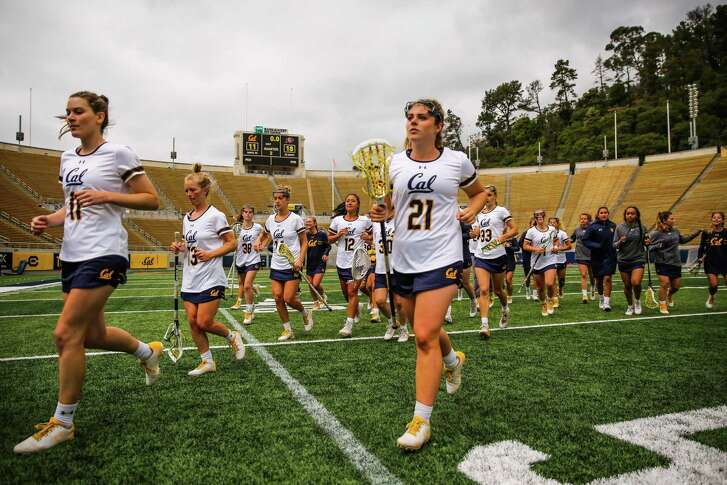 Cal women's lacrosse players walk off the field after a game between Cal and Colorado at California Memorial Stadium in Berkeley, California, on Sunday, April 15, 2018.