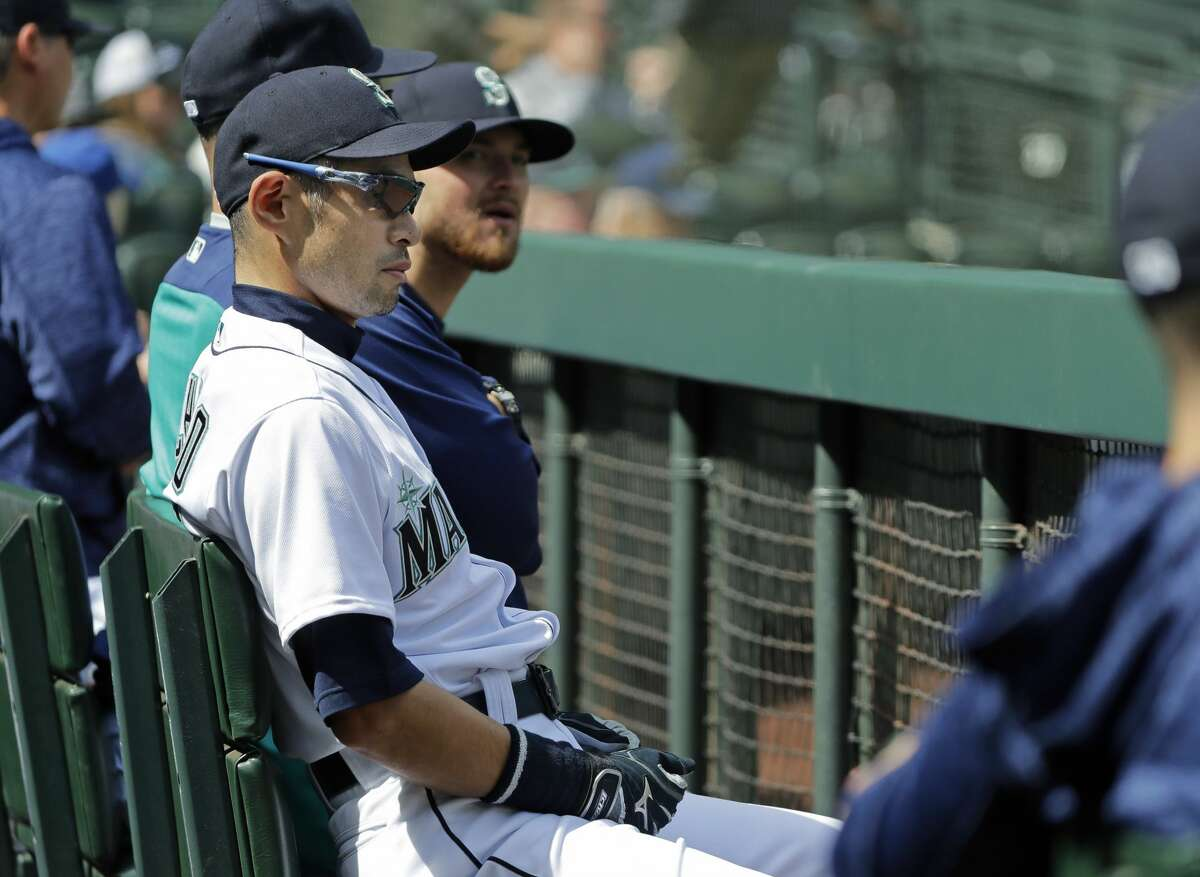 Seattle Mariners' Ichiro Suzuki sits in the dugout during the first inning of a baseball game against the Houston Astros, Thursday, April 19, 2018, in Seattle. Suzuki was not in the starting lineup for the game. (AP Photo/Ted S. Warren)