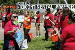 United Airlines catering workers gather along JFK at Greens Road as they demonstrate to unionize on Thursday, April 19, 2018, in Houston. The food service workers are trying to join a union and getting pushback from the airline. ( Brett Coomer / Houston Chronicle )