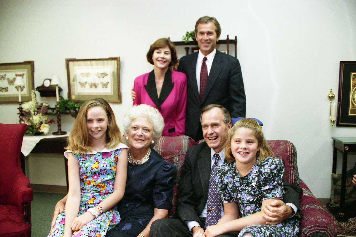 President George Bush poses with his family, clockwise from top left, Laura and George W. Bush, granddaughter Jenna, first lady Barbara Bush and granddaughter Laura in August 1992 during the GOP convention in Houston.