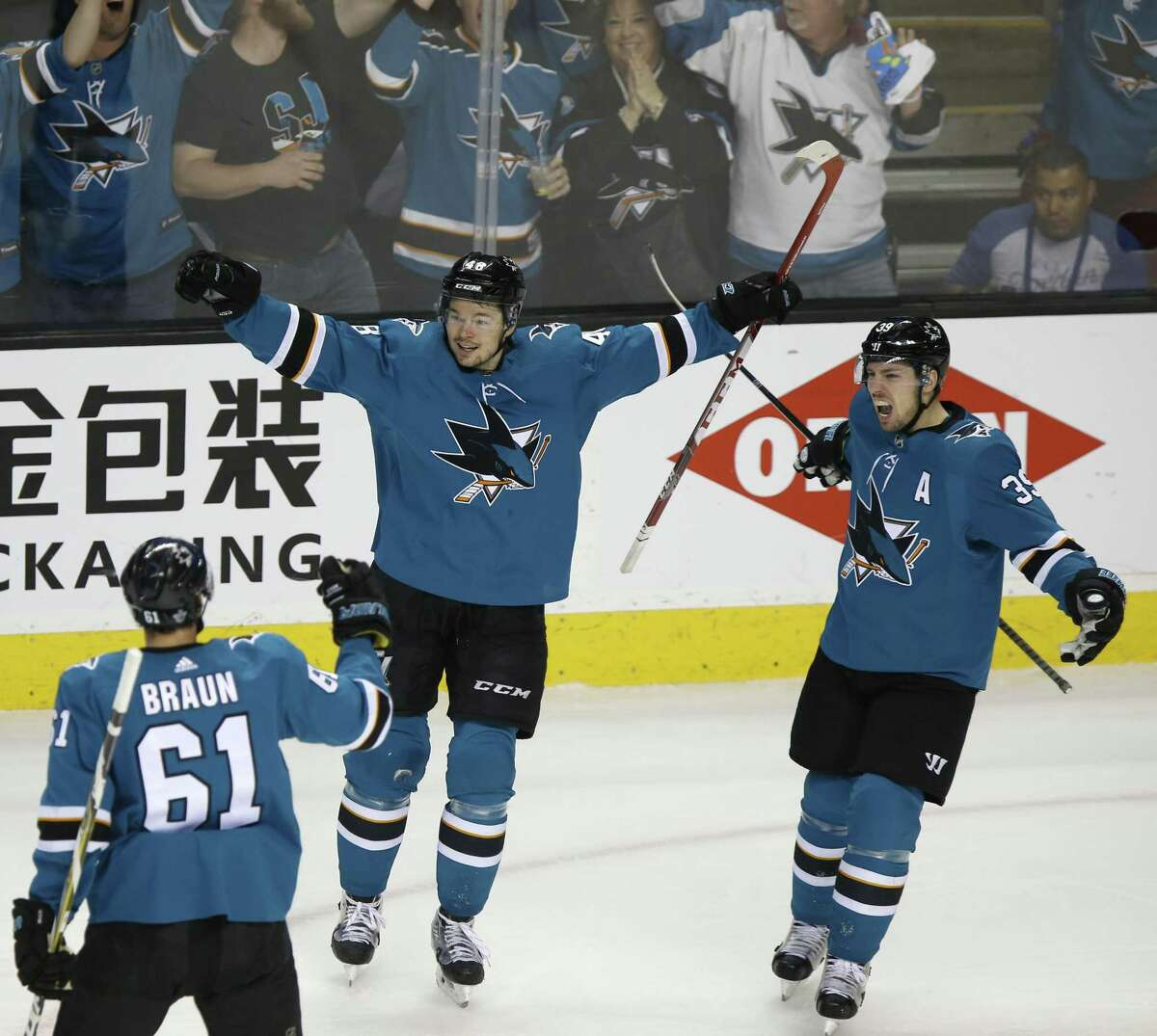 San Jose Sharks' Justin Braun (61), San Jose Sharks' Tomas Hertl (48), who celebrates after scoring 2-1 goal with San Jose Sharks' Logan Couture (39) against Anaheim Ducks in the third period of Game 4 of an NHL third round playoff series on Wednesday, April 18, 2018 at the SAP Center in San Jose, California.