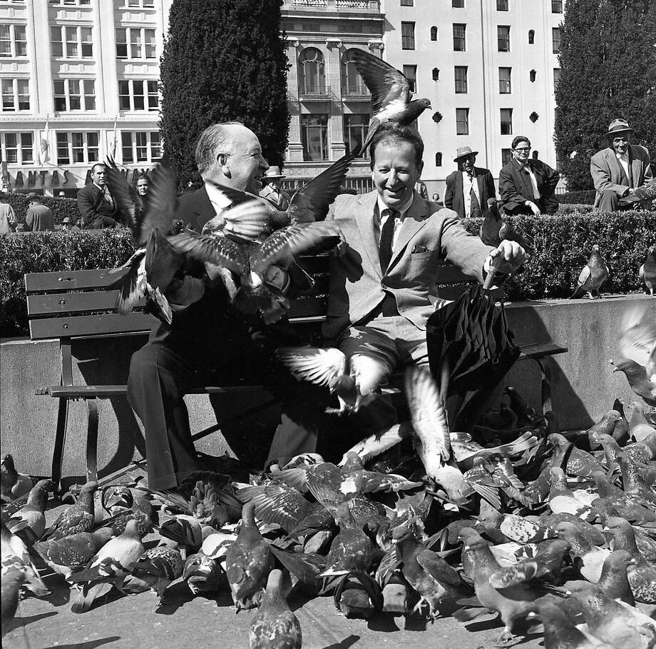 """April 1, 1963: Herb Caen and Alfred Hitchcock have fun in Union Square talking about Hitchcock's new movie """"The Birds."""" Photo: Chronicle File / The Chronicle"""
